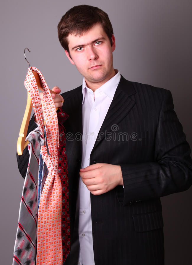 Download Businessman Can't Select A Tie Stock Image - Image: 12602141
