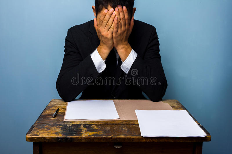 Businessman cannot decide what to do stock images