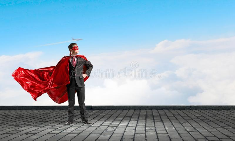 Strong and powerful as super hero . Mixed media royalty free stock photos