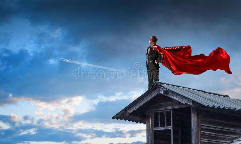Strong and powerful as super hero . Mixed media stock photography