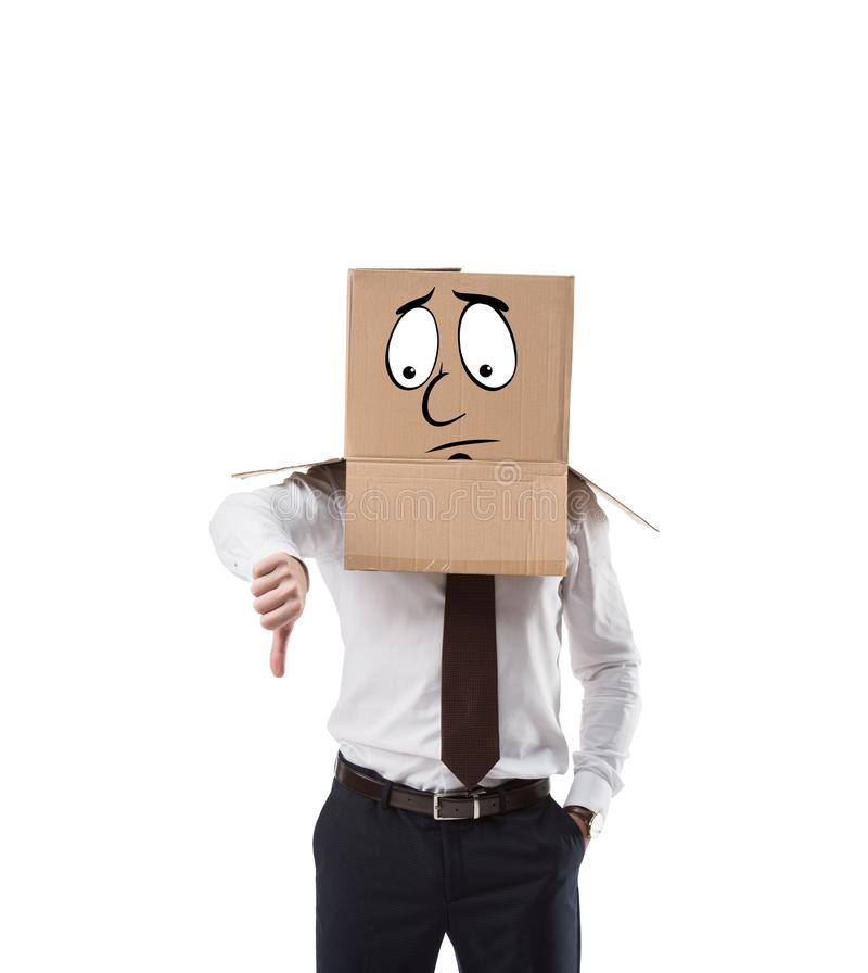 businessman with cardboard box on his head showing thumb down stock photography