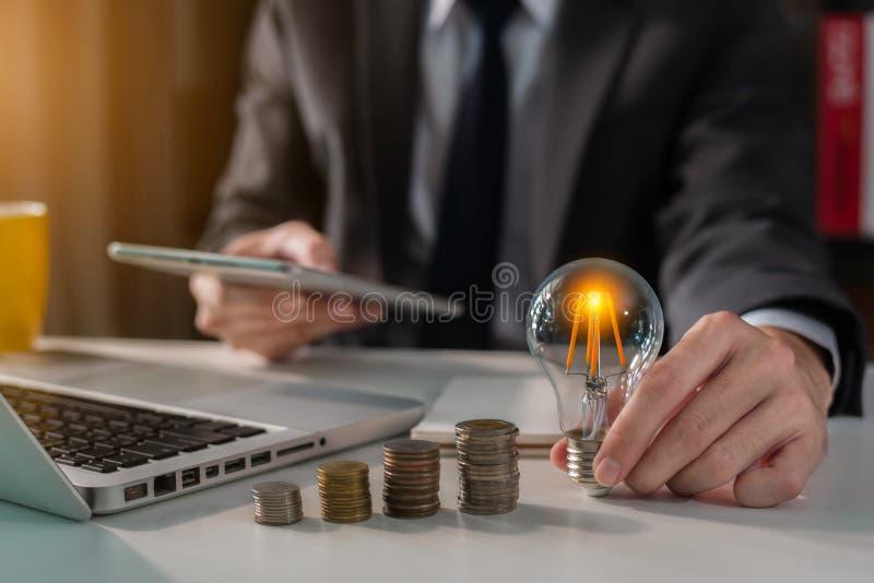 Businessman carry light bulbs with the idea of saving money. royalty free stock photo