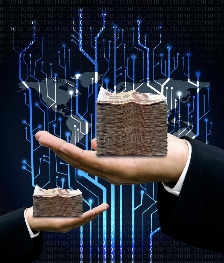 Businessman carry money with digital tree circuit and world map stock photography