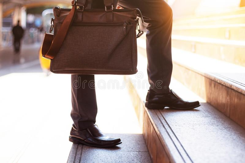 Businessman carrying a bag. royalty free stock photography