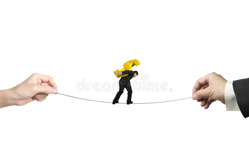 Businessman carrying dollar sign balancing tightrope with hands royalty free stock image