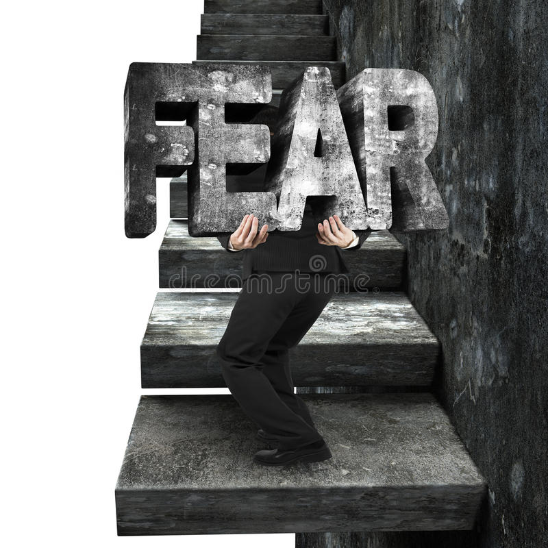 Businessman carrying fear concrete word on old concrete stairs. Businessman carrying big 3D fear concrete word on old concrete stairs, on white background royalty free stock photography