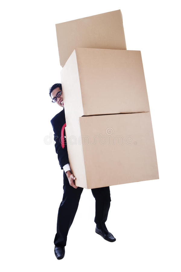 Download Businessman Carrying Heavy Boxes Stock Photo - Image: 23559142