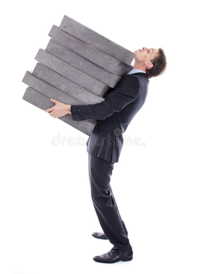 Businessman carrying high burden. Of debt. Stacked heavy stones stock photography
