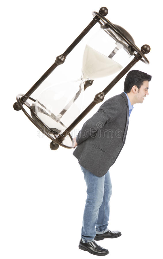 Businessman carrying a hourglas stock images