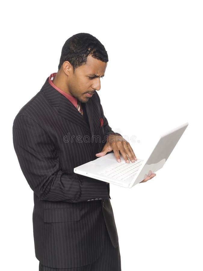 Businessman - Carrying Laptop Stock Photos