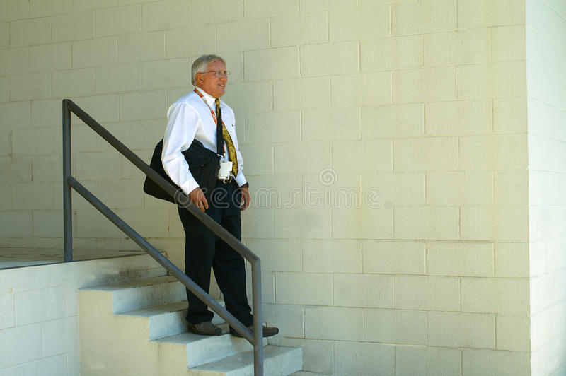 Download Businessman Carrying Laptop Going Down Steps Stock Photo - Image of serious, modern: 23210094