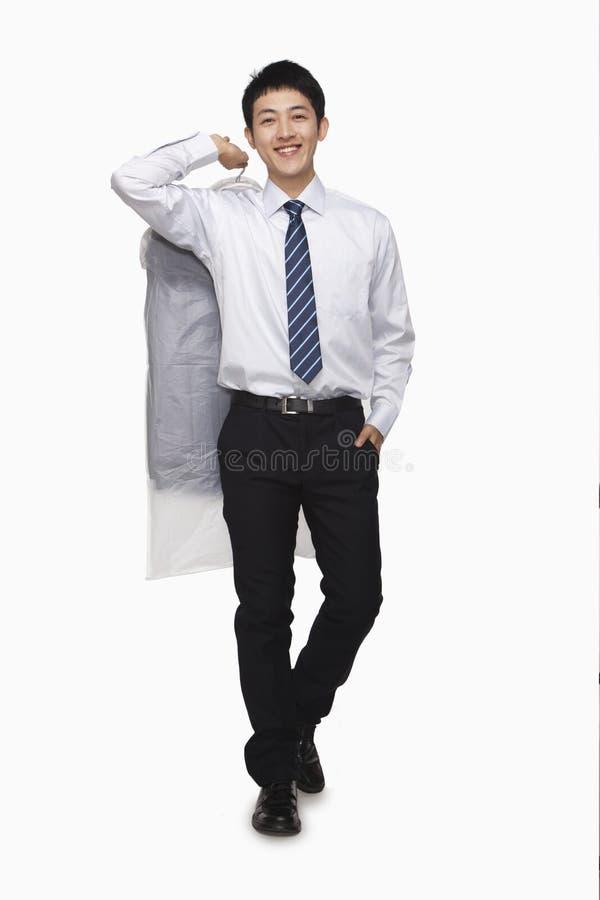 Download Businessman Carrying Laundered Shirt, Studio Shot Stock Photo - Image: 31131700