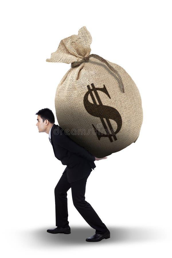 Businessman carrying money bag stock image