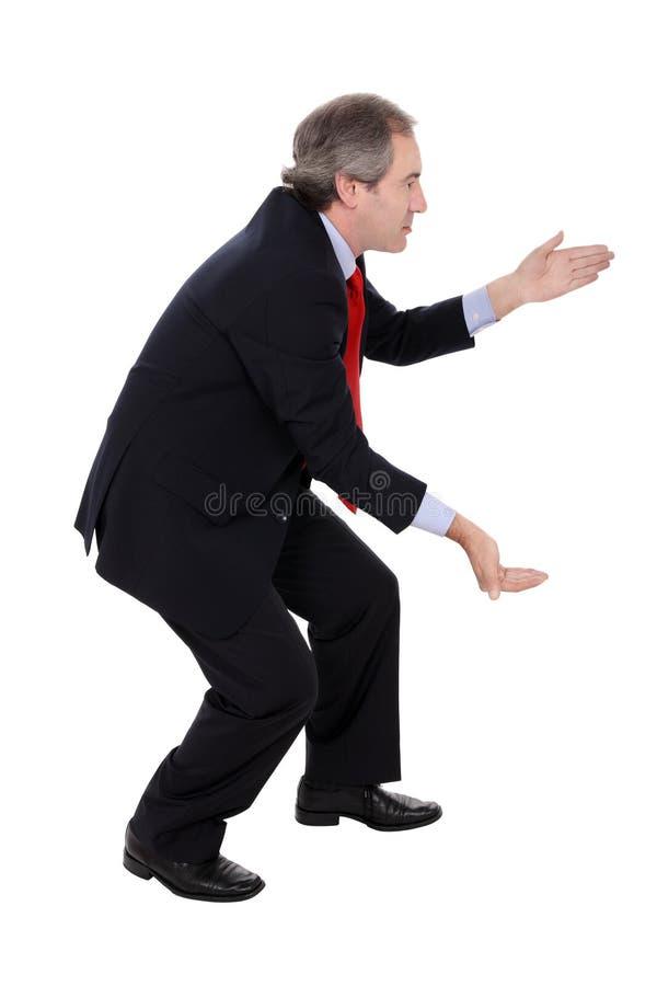 Businessman carrying something stock image