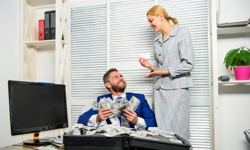 Businessman with cash client of bank. Office manager administrator holds bank card. Man business owner sit office pile stock image