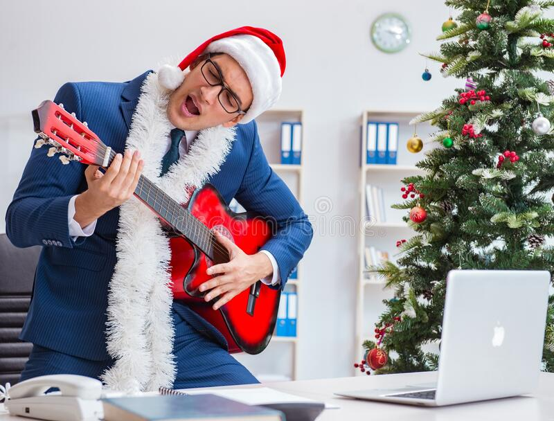 Businessman celebrating christmas holiday in the office royalty free stock photos