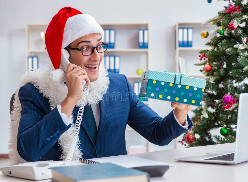Businessman celebrating christmas holiday in the office stock photography