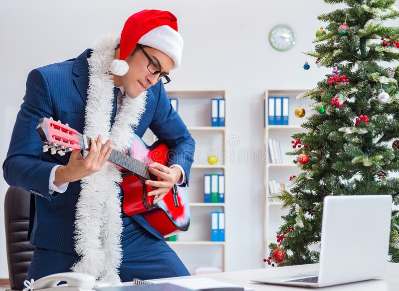 Businessman celebrating christmas holiday in the office royalty free stock images