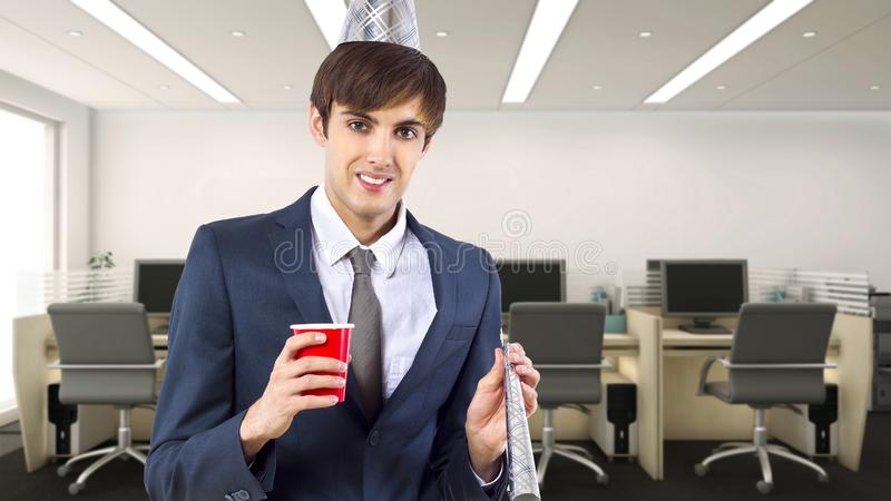Businessman Celebrating in the Office. Businessman celebrating by himself alone in the office.  He is happy because of a birthday, holiday or a successful job royalty free stock image