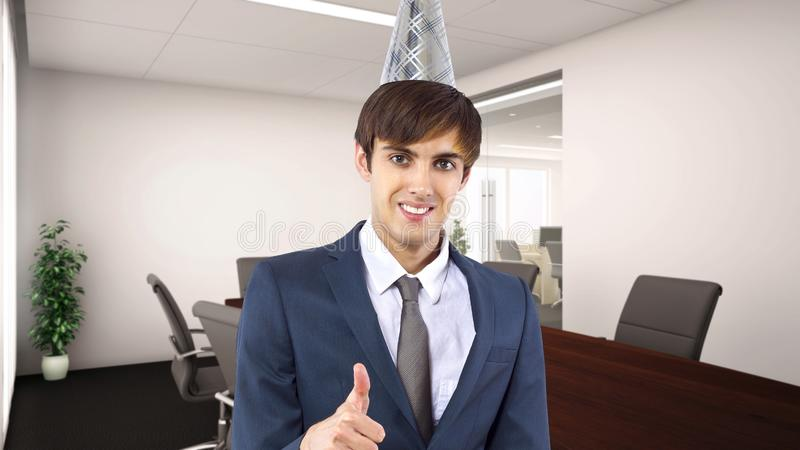 Businessman Celebrating in the Office. Businessman celebrating by himself alone in the office.  He is happy because of a birthday, holiday or a successful job royalty free stock photos