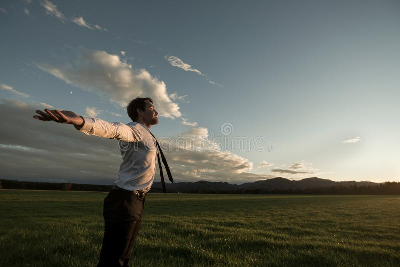 Businessman celebrating a new day stock image