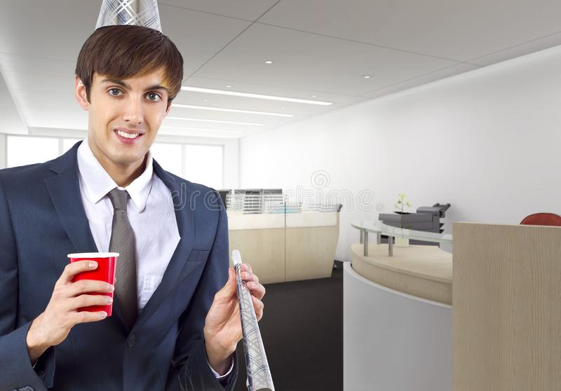Businessman Celebrating in the Office. Businessman celebrating by himself alone in the office.  He is happy because of a birthday, holiday or a successful job stock photos