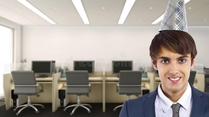 Businessman Celebrating in the Office. Businessman celebrating by himself alone in the office.  He is happy because of a birthday, holiday or a successful job royalty free stock images