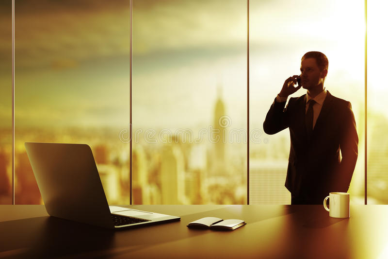 Businessman with cellphone stock images
