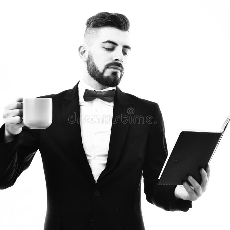 Businessman or CEO with beard, fancy suit holds cyan cup stock photo