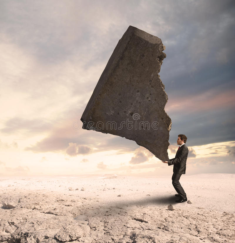 Businessman challenging the difficulties stock images