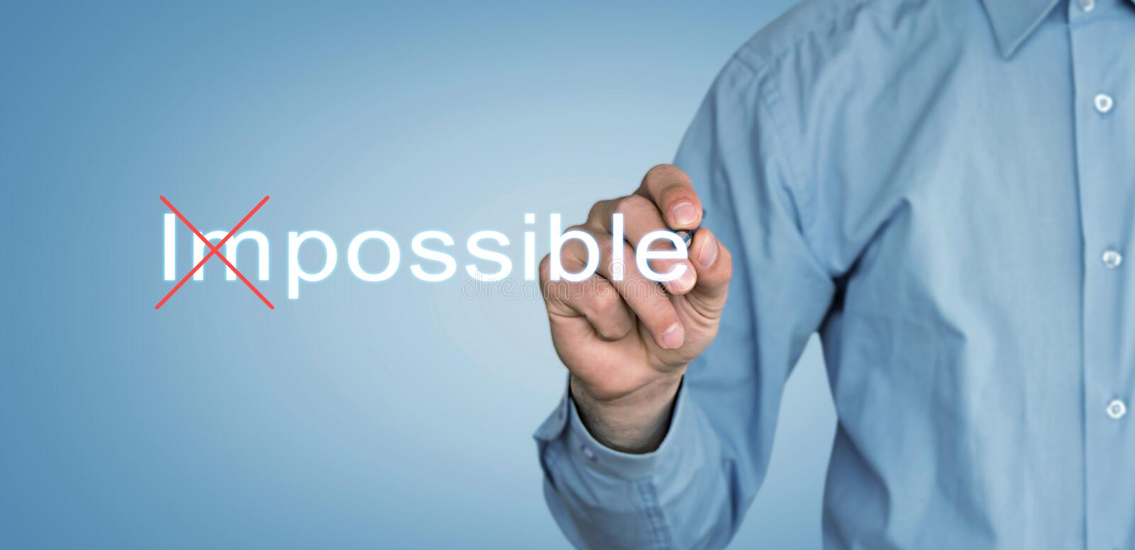 Businessman change Impossible to Possible on screen. stock photo