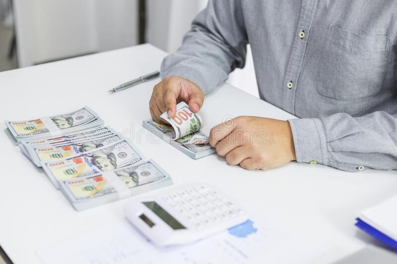 Businessman checking bills. taxes bank account balance and calculating annual financial statements of company. Accounting Audit. Businessman checking bills taxes royalty free stock photo