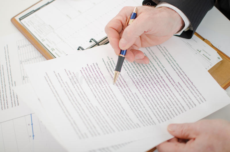 Businessman checking a document royalty free stock photography