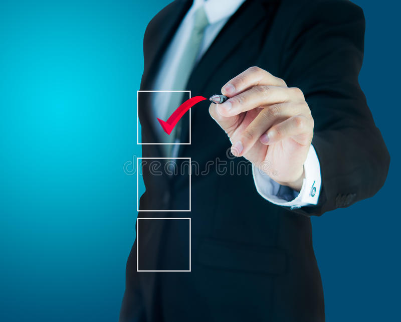 Businessman checking mark checklist marker. On blue background royalty free stock image
