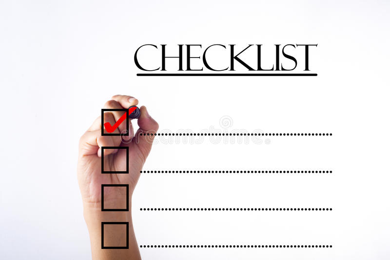 Businessman checking mark on checklist with marker over white royalty free stock images