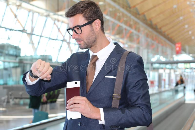 Businessman checking the time in the airport royalty free stock photography