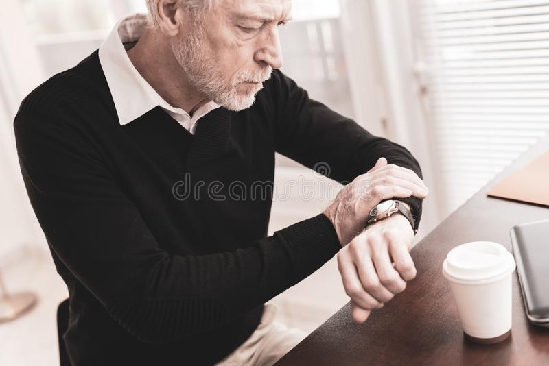 Businessman checking time on his wrist watch royalty free stock photo