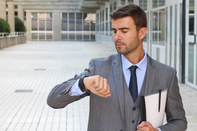 Businessman checking the time isolated royalty free stock photos