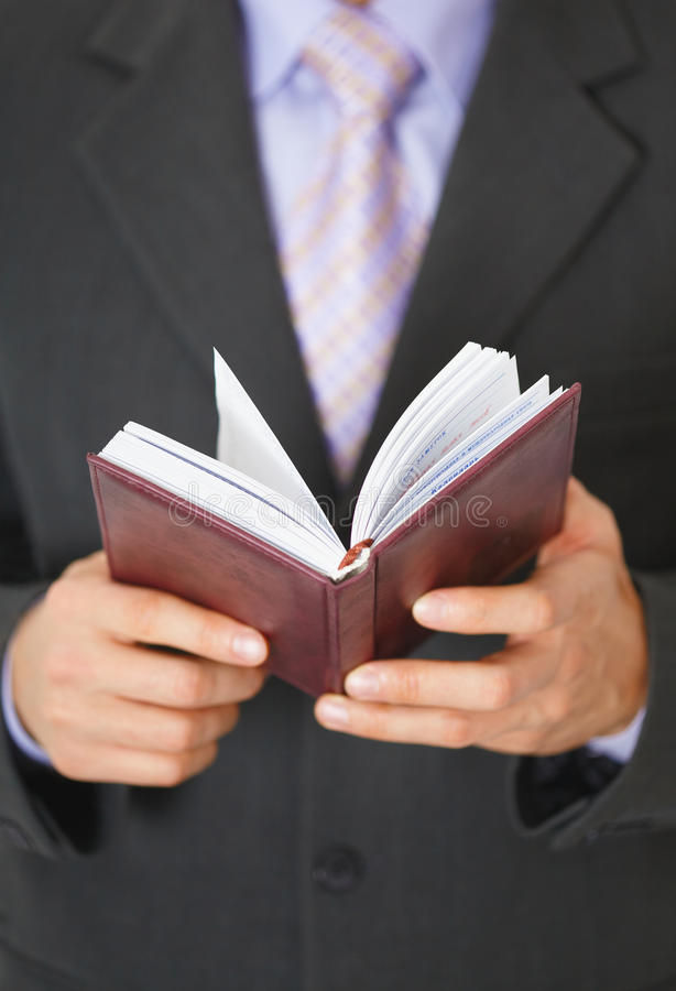 Download Businessman Checks Schedule Of Day In Organizer Royalty Free Stock Photos - Image: 14018788