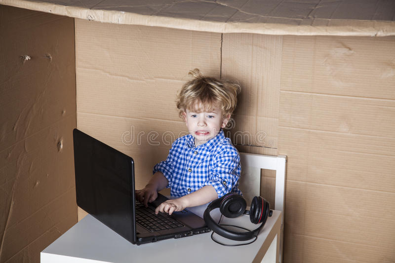 Businessman child is in trouble with the computer, curve face. Problem at work stock photos