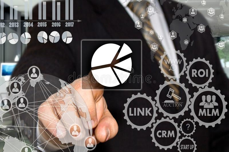 The businessman chooses  button  chart, business diagram on the touch screen with a futuristic background .The concept  of data royalty free stock photography