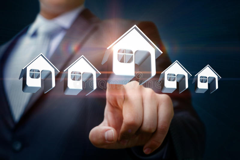 Businessman chooses and clicks on a model home. stock images