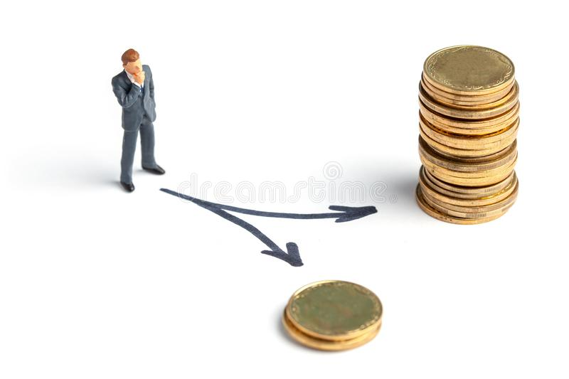 Businessman chooses the right path to big money. Different ways to achieve the goal, the right and wrong choice.  stock photo