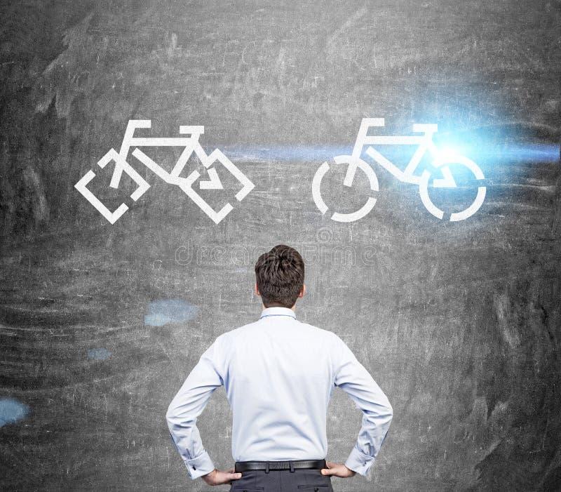 Businessman choosing bike stock image