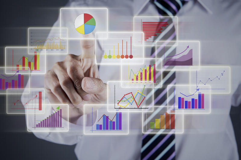 Businessman choosing chart on business interface. For presenting business data stock photography