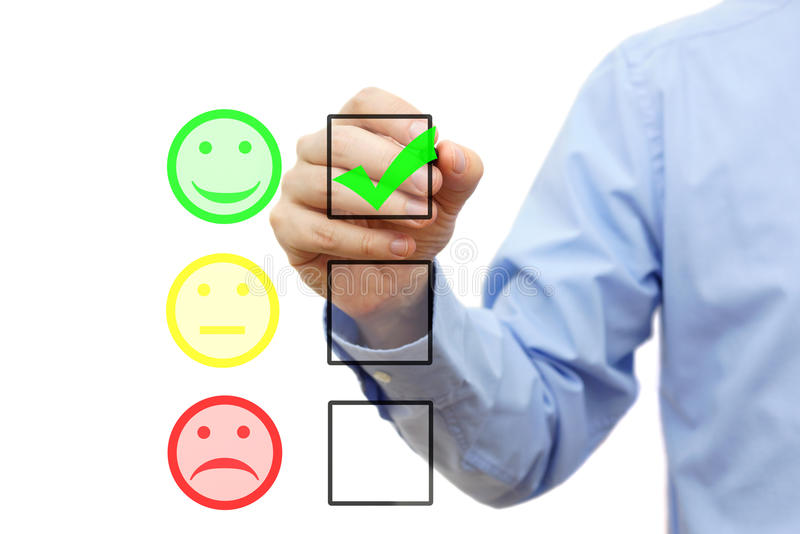Businessman is choosing smile on checklist. Customer satisfaction concept stock image
