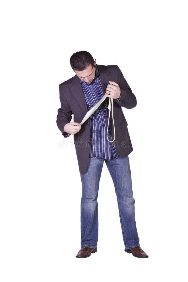 Businessman Choosing A Tie stock photography