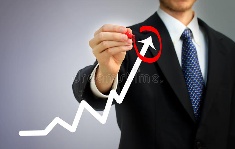 Businessman circling a rising arrow royalty free stock image