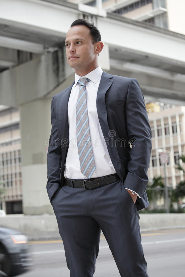 Businessman in the city. Handsome businessman in a suit stock photography