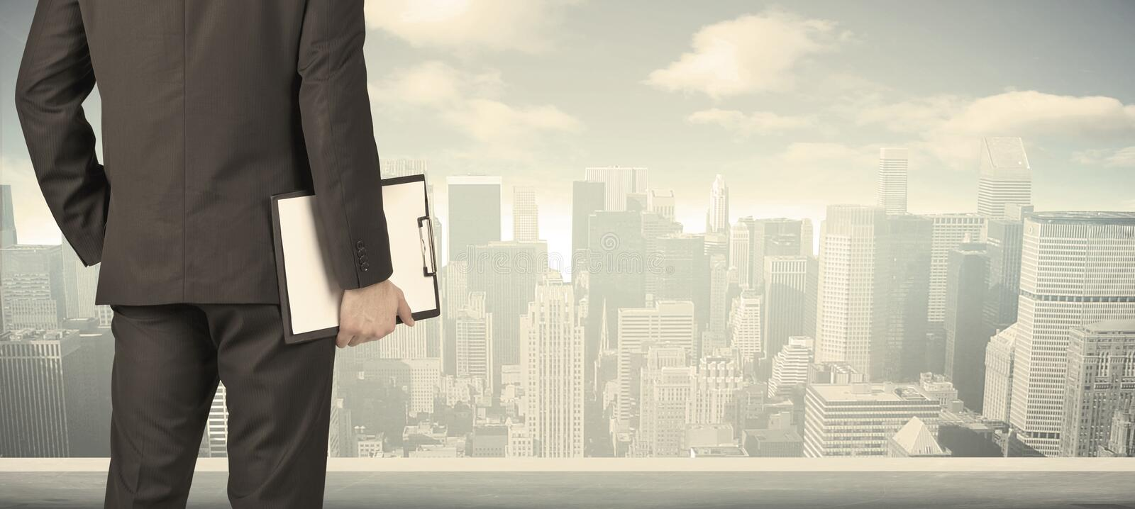 Businessman with city view royalty free stock photography